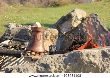Coffee pot on a fire