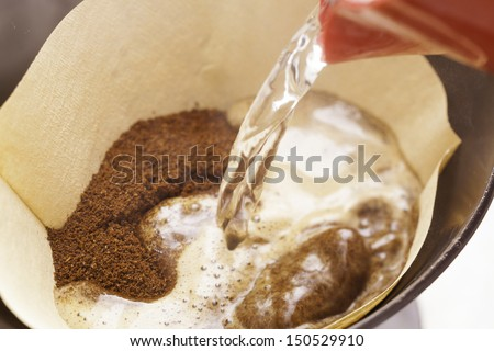 coffee powder in the filter - stock photo