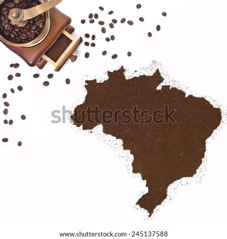 Coffee powder in the shape of Brazil and a decorative coffee mill.(series) - stock photo