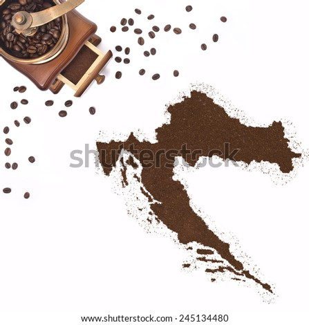 Coffee powder in the shape of Croatia and a decorative coffee mill.(series) - stock photo