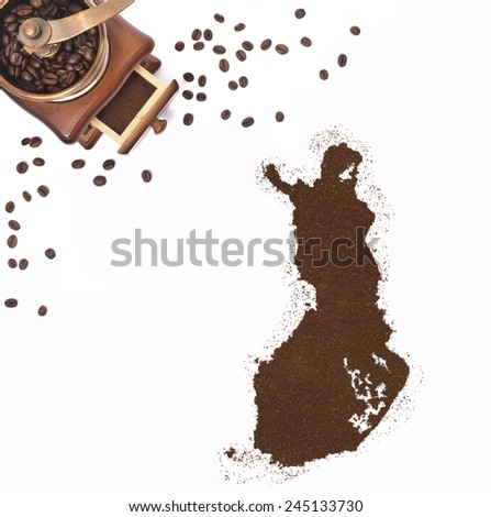 Coffee powder in the shape of Finland and a decorative coffee mill.(series) - stock photo