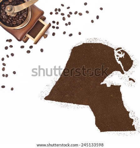 Coffee powder in the shape of Kuwait and a decorative coffee mill.(series) - stock photo