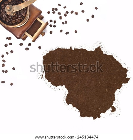 Coffee powder in the shape of Lithuania and a decorative coffee mill.(series) - stock photo
