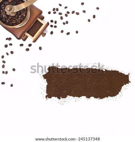 Coffee powder in the shape of Puerto Rico and a decorative coffee mill.(series) - stock photo