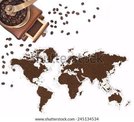 Coffee powder in the shape of the world and a decorative coffee mill.(series) - stock photo