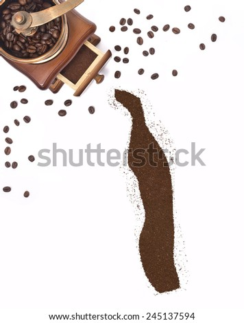 Coffee powder in the shape of Togo and a decorative coffee mill.(series) - stock photo