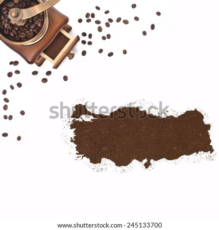 Coffee powder in the shape of Turkey and a decorative coffee mill.(series) - stock photo