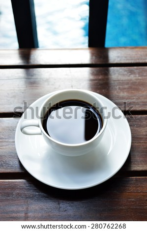 Coffee relaxing afternoon poolside - stock photo