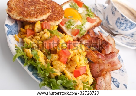 coffee, scrambled eggs, round french toasts, eggie bread and bacon