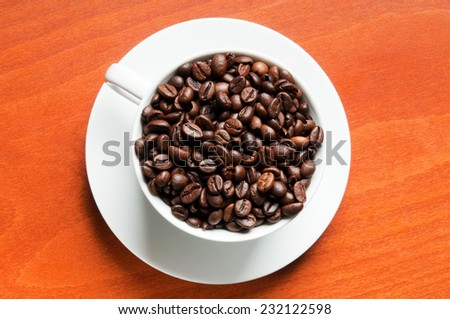 coffee seeds in a white cup