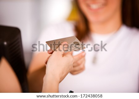 Coffee Shop: Giving Cashier a Credit Card - stock photo