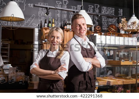 Coffee shop owners standing with their hands crossed