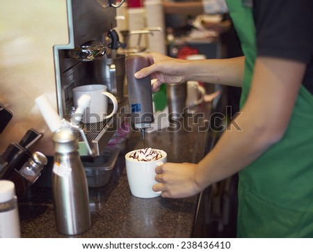 coffee shop staff making coffee - stock photo