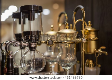 Coffee siphon POTS on the shelf - stock photo