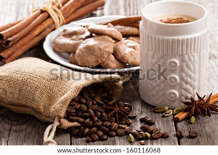 Coffee, spices and chocolate meringue cookies - stock photo