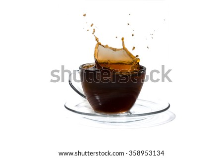 Coffee splash and cup of coffee isolated on white background