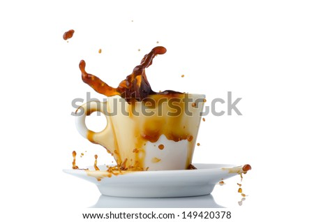Coffee splashing out of a cup - stock photo