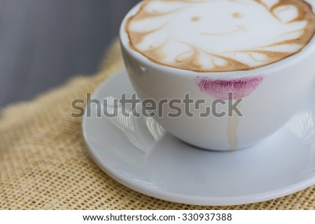 Coffee stains lipstick purple color on cup - stock photo
