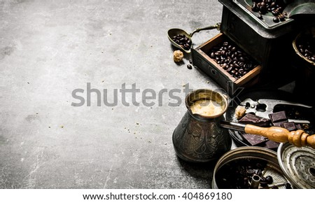 Coffee style. Coffee pot and different tools. On a stone background.  - stock photo