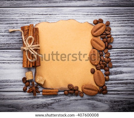 Coffee, sugar, cinnamon, cookies and vintage paper. Selective focus, space for text, top view