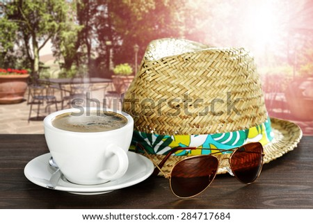 coffee sunglasses hat and cafe  - stock photo
