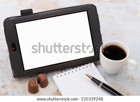 Coffee, tablet PC, pen and notepad