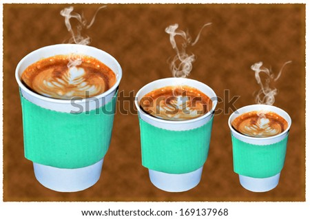 Coffee takeaway cups in three size on brown background - stock photo