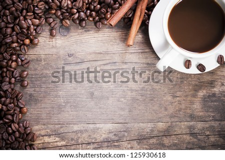 Coffee tastefully presented, next to coffee beans. - stock photo