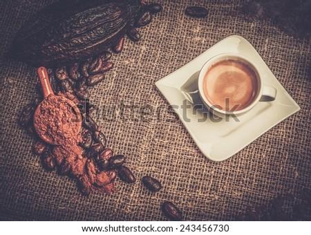Coffee theme still-life on sackcloth - stock photo