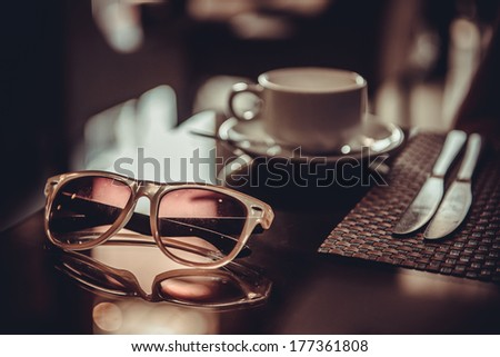 Coffee time. Cup of coffee in the restaurant table - stock photo