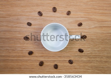 Coffee Time - Empty coffee cup and clock of coffee beans - stock photo