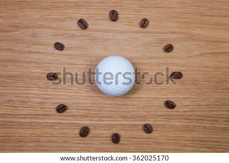 Coffee Time - White golf ball and clock of coffee beans - stock photo