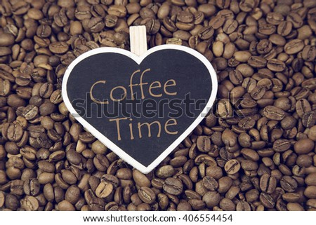 coffee time writing heart chalkboard with coffee beans - stock photo