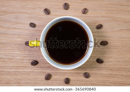 Coffee Time -  Yellow  cup of coffee and clock of coffee beans - stock photo