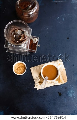 Coffee with caramel milk and coffee machine taken on dark rustic background. Top view.  - stock photo