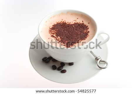 coffee with chocolate on top in the shap of a heart - stock photo