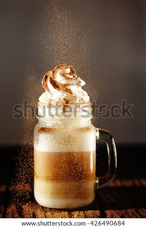 coffee with cream and cinnamon - stock photo