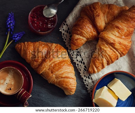 Coffee with croissants - traditional french breakfast - stock photo
