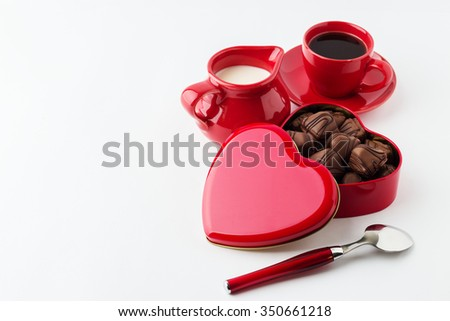 Coffee with milk, chocolate candy. Isolated on white background.