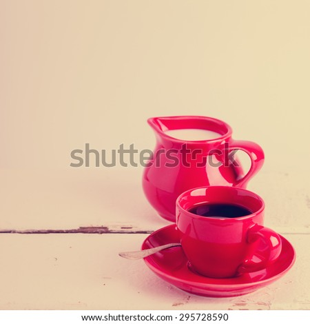 Coffee with milk. The image is tinted. Selective focus. - stock photo