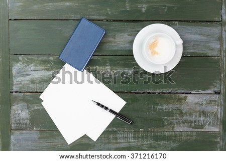 Coffee with note or paper on wood background, flat lay
