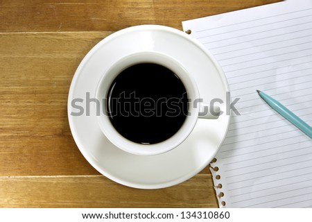 Coffee with note paper and pen