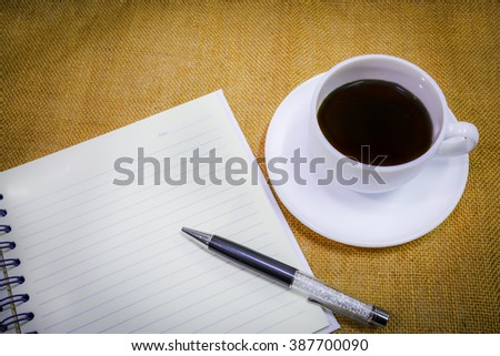 coffee with notebook for memory