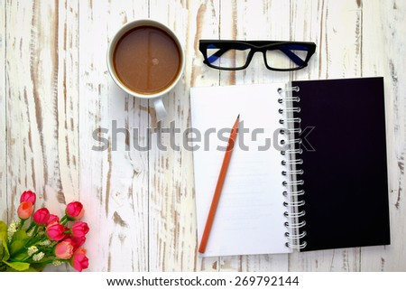 Coffee with notepad and pen - stock photo