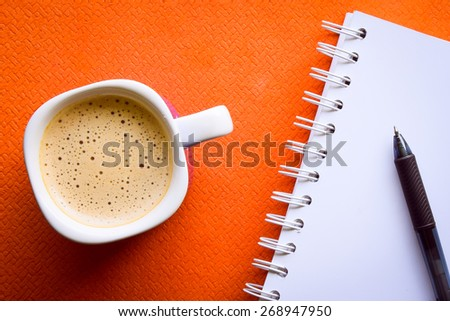 Coffee with notepad and pen  (top view) - stock photo