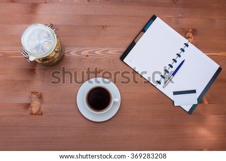 Coffee with pencil on wood table and credit card