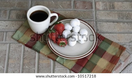 Coffee with strawberries and donut holes - stock photo