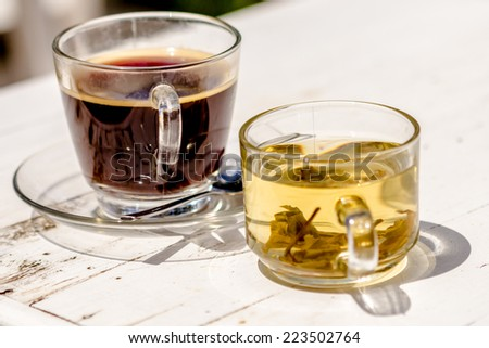 coffee with tea on white wooden table