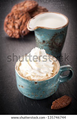 Coffee with whipped cream and chocolate cookies with chocolate chips