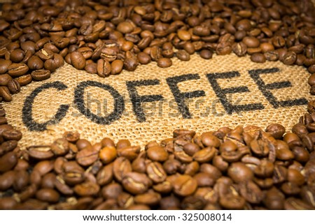 Coffee word and beans